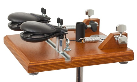 Professional castanet machine with a pair of castanets mounted on a stand